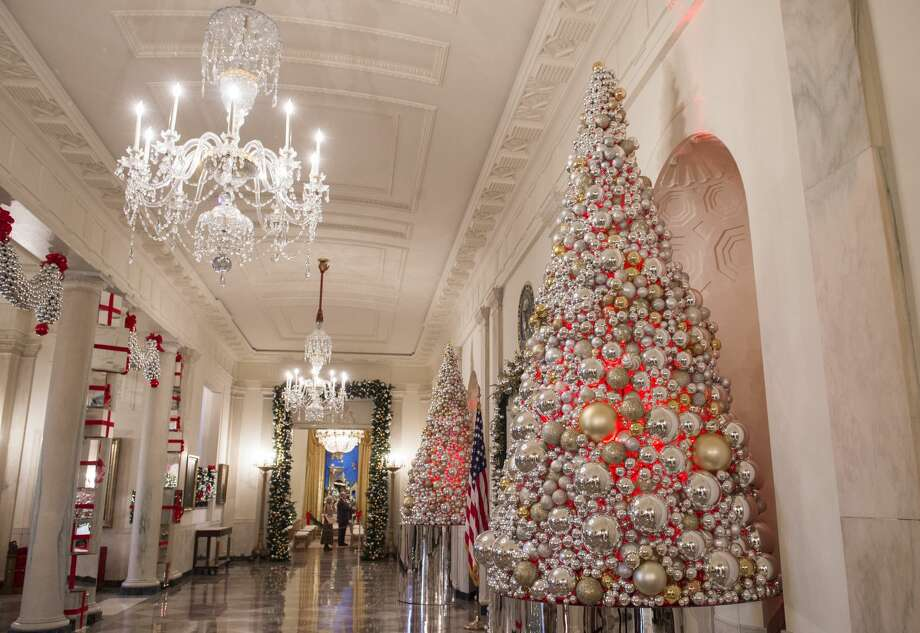 "Christmas trees and holiday decorations in the theme of, ""The Gift of the Holidays,"" are seen outside in Cross Hall of the White House in Washington, DC, November 29, 2016. Photo: SAUL LOEB/AFP/Getty Images"