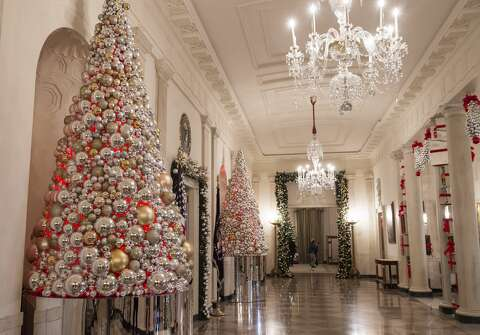 christmas trees and holiday decorations in the theme of the gift of the holidays - Christmas Decorations 2016
