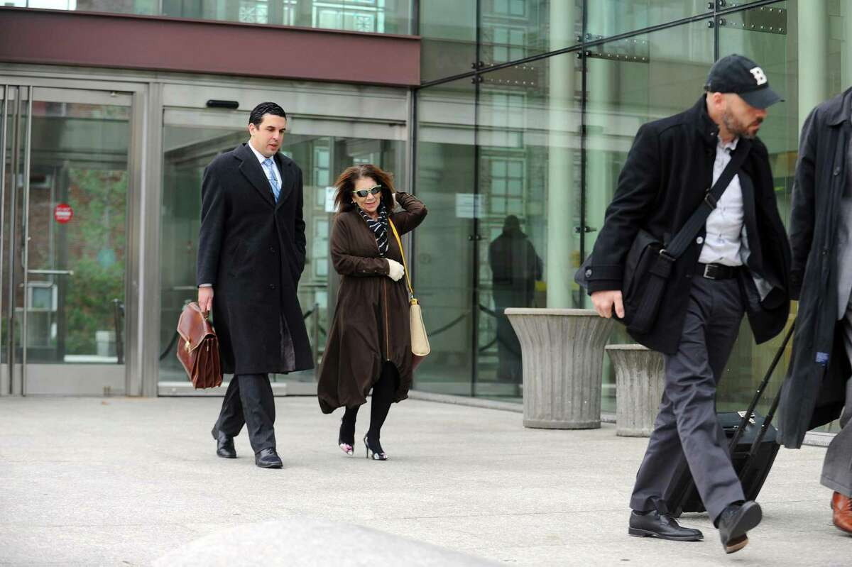 Former Stamford High School Principal Donna Valentine and attorney Ryan O'Neil leave the state Superior Court in Stamford, Conn. on Monday, Nov. 21, 2016 following a disposition hearing. This marks the end of Valentine's accelerated rehab program and her charges will be dismissed.