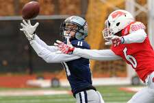 Staples' Kevin Rabacs attempts to make a catch defended by Greenwich's Jeremiah Harris in Thursday's game.