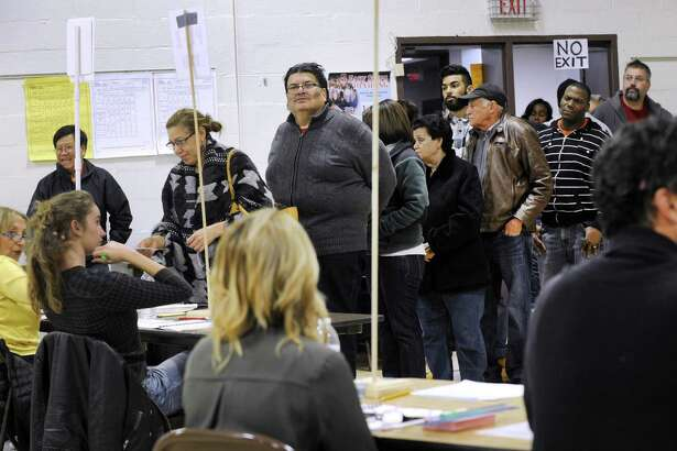 The voting line extends into the hallway Tuesday afternoon at Park Avenue School polling place  in Danbury Tuesday, Nov. 8, 2016.