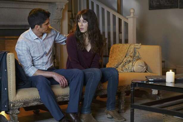 Nicholas Gonzalez as Detective Marco and Troian Bellisario as Spencer in 'Pretty Little Liars' on Freeform.