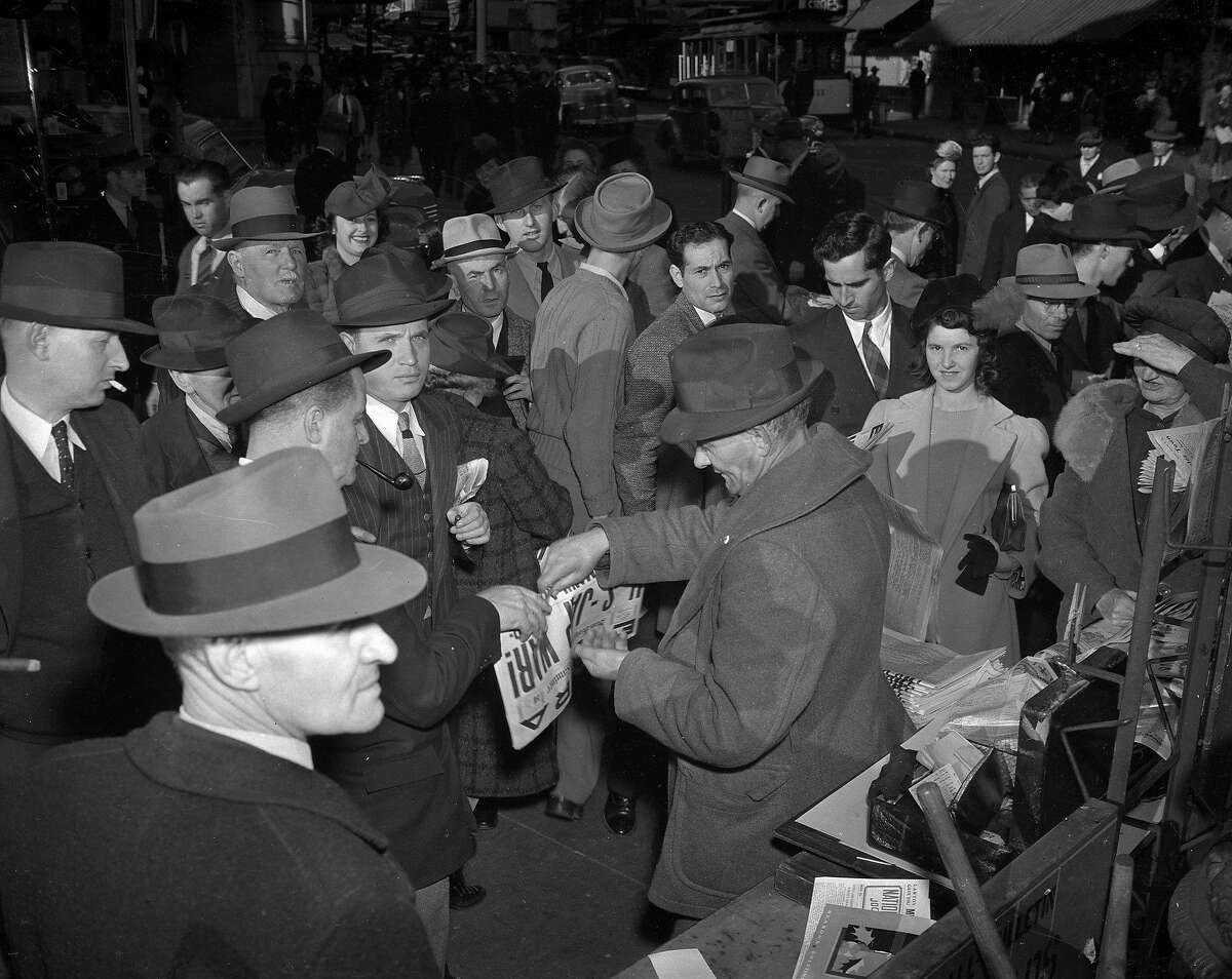 Customers at the newsstand, check out the first edition of the December 8th San Francisco Chronicle announcing the Japanese bombing of Pearl Harbor.