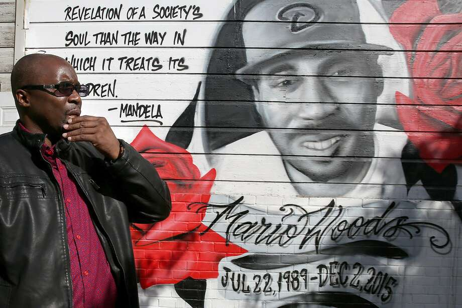 Shawn Richards, president of Brothers Against Guns, at the mural of Mario Woods at Third and Oakdale streets in San Francisco. Richards was the spokesman for Woods' family after his fatal shooting by police. Photo: Liz Hafalia, The Chronicle