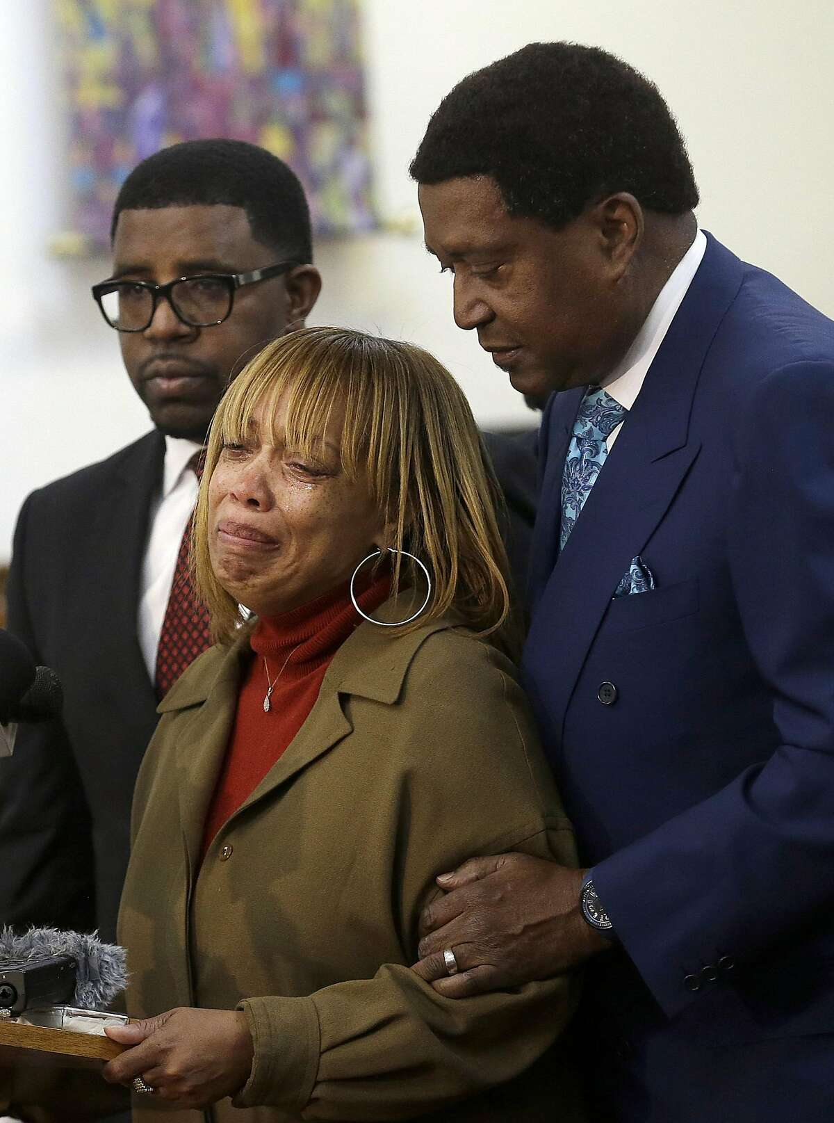 Attorney John Burris, right, comforts Gwendolyn Woods, the mother of Mario Woods, the man killed by San Francisco police after they say he appeared to raise an 8-inch knife and approach an officer, as she speaks at a news conference in San Francisco, Monday, Jan. 18, 2016. The family has asked the U.S. Department of Justice to investigate the officers who shot Woods on Dec. 2, 2015, and review the department's use of deadly force, stops, and detention and searches of African American and Latino citizens for possible civil rights violations. (AP Photo/Jeff Chiu)