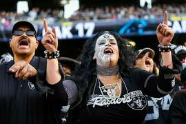 Oakland Raiders fan Eye Candee (right) cheered during a game against the  Carolina Panthers which ended in a Raiders victory, of 35-32, at the Oakland Colliseum, in Oakland, California, on Sunday November 27, 2016.