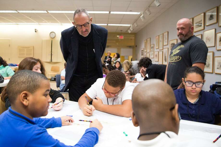 Architect Thom Mayne overlooks a group of students sketching their own architectural designs at the Westport Library in Westport, Conn. on Tuesday, November 29, 2016. Mayne worked with the students in the morning on their own architectural designs and spoke with them about architecture and whats it like to be an architect. Photo: Chris Palermo / For Hearst Connecticut Media / Norwalk Hour Freelance