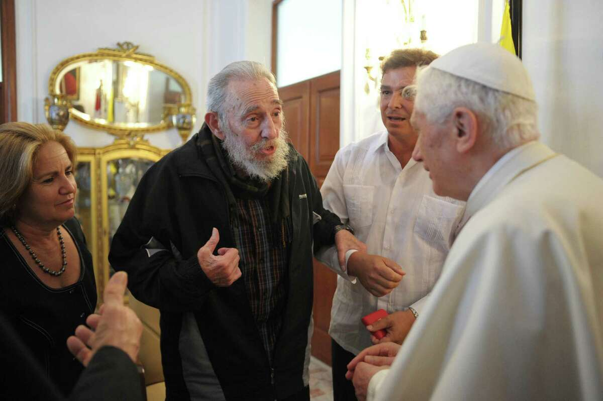 FILE - In this March 28, 2012 file photo made available by the Vatican newspaper Osservatore Romano, Pope Benedict XVI, right, meets with Cuba's leader Fidel Castro in Havana, Cuba. Former President Fidel Castro, who led a rebel army to improbable victory in Cuba, embraced Soviet-style communism and defied the power of 10 U.S. presidents during his half century rule, has died at age 90. The bearded revolutionary, who survived a crippling U.S. trade embargo as well as dozens, possibly hundreds, of assassination plots, died eight years after ill health forced him to formally hand power over to his younger brother Raul, who announced his death late Friday, Nov. 25, 2016, on state television. (AP Photo/Osservatore Romano, File)