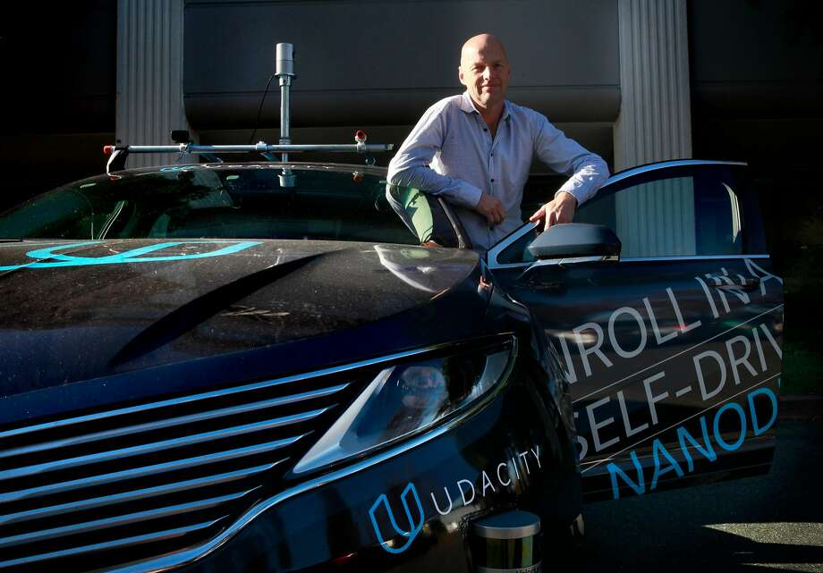 Sebastian Thrun, a pioneer of self-driving technology is the founder of Udacity an online learning company that offers nano degrees to prepare students for technology jobs, is seen with their self driving car in front of their headquarters in Mountain View,, California on Tuesday November 29, 2016. Photo: Michael Macor, The Chronicle