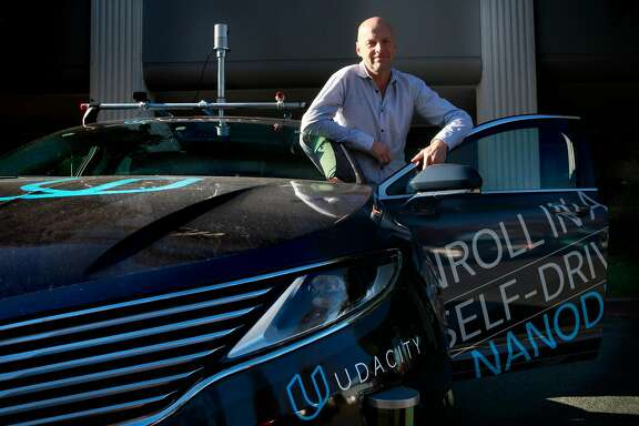 Sebastian Thrun, a pioneer of self-driving technology is the founder of Udacity an online learning company that offers nano degrees to prepare students for technology jobs, is seen with their self driving car in front of their headquarters in Mountain View,, California on Tuesday November 29, 2016.