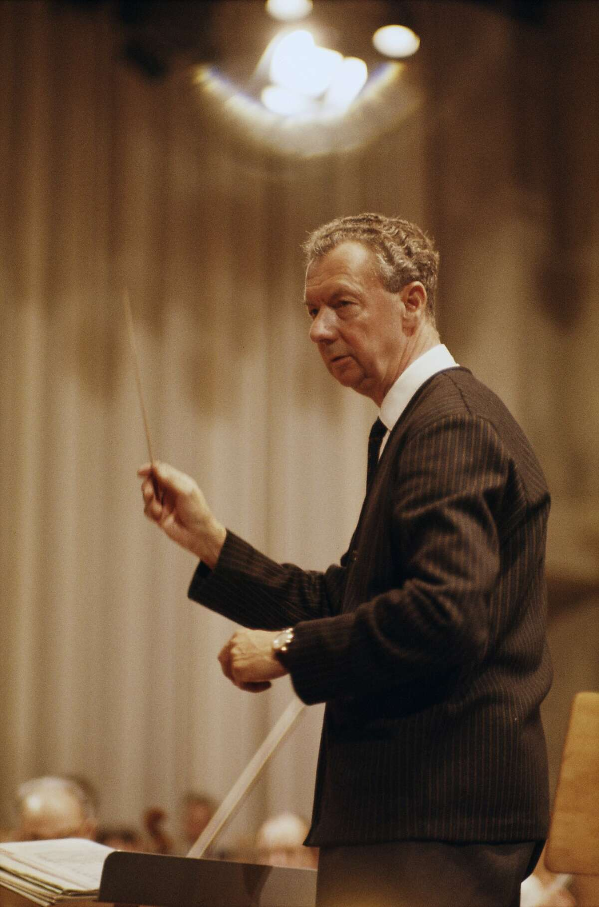 English composer Benjamin Britten (1913 - 1976) conducting, circa 1965.