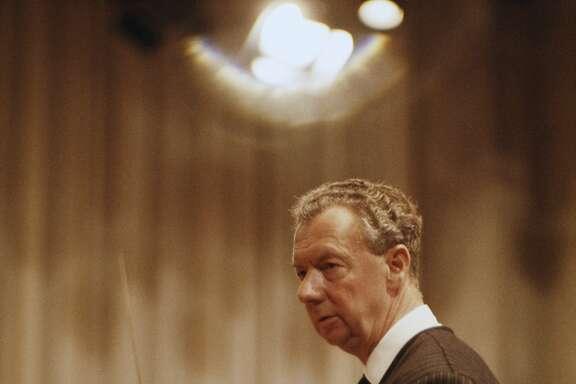 English composer Benjamin Britten (1913 - 1976) conducting, circa 1965.
