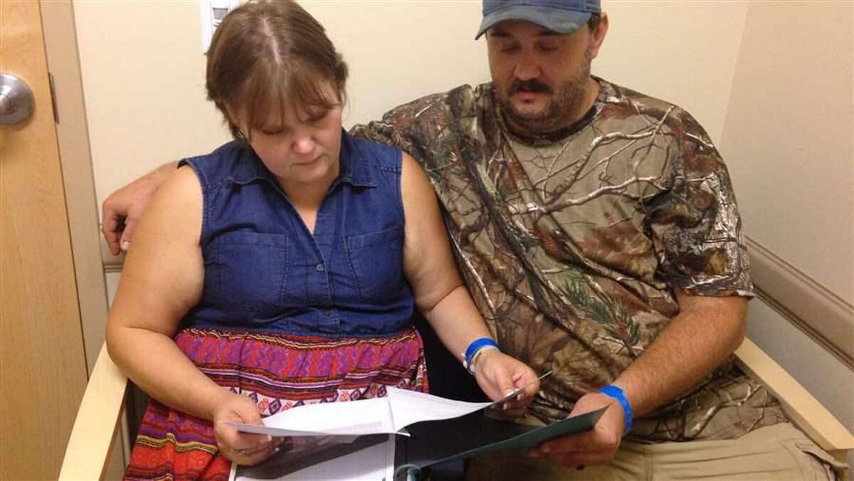 Jillian and Glen Coleman look over counseling and group therapy schedules at Valley Health in Huntington, West Virginia. Like much of the rest of the country, the city's opioid treatment centers are struggling to meet burgeoning demand. (Christine Vestal/Pew Charitable Trusts)
