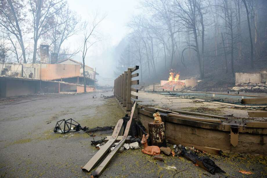 Smoke clouded the air around Gatlinburg, Tenn., on Tuesday as officials continued search-and-rescue missions. Wildfires killed three people, destroying homes and forcing more than 14,000 residents and tourists to evacuate the area. Photo: Michael Patrick, MBO / ©2016
