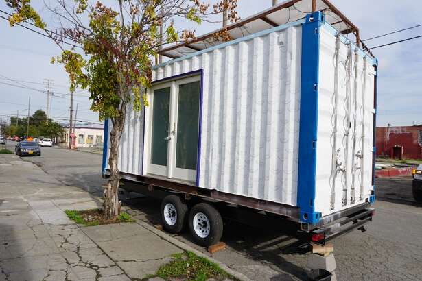 This is Luke Iseman's container home, parked on the street in West Oakland. He hopes to build a business building tiny homes and selling them for under $50,000