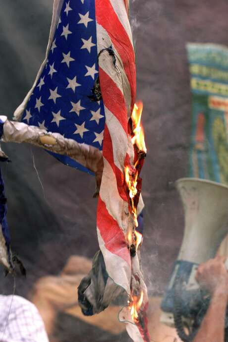"President-elect Donald Trump said anyone who burns an American flag should face unspecified ""consequences,"" such as jail or a loss of citizenship. Photo: LEFTERIS PITARAKIS, STF / AP"