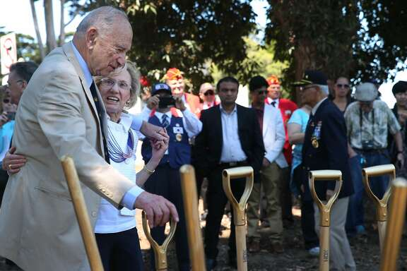 Quentin Kopp and outgoing Presidio Trust chairwoman Nancy Hellman Bechtle prepare to shovel dirt for the groundbreaking ceremony for a Korean War Memorial at the Presidio National Cemetery in San Francisco, Calif. on Saturday, July 11, 2015.