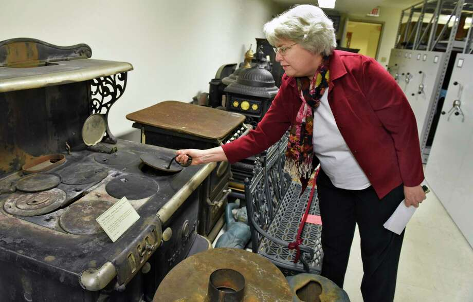Curator Stacy Draper with 19th century Troy-made cast iron stoves being prepped for a new exhibition at the Rensselaer County Historical Society Thursday Nov. 17, 2016 in Troy, NY.  (John Carl D'Annibale / Times Union) Photo: John Carl D'Annibale / 20038833A