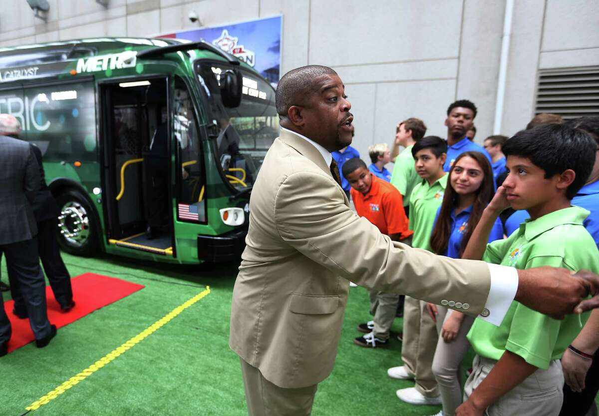 Metro's Terence Fontaine greets high school students during the unveiling of a battery electric bus that Metro will be using in a pilot program for the next three months, Tuesday, Nov. 29, 2016, in Houston. ( Mark Mulligan / Houston Chronicle )