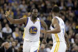 Draymond Green (23) congratulates Ian Clark (21) after Clark hit a three pointer in the first half as the Golden State Warriors played the Atlanta Hawks at Oracle Arena in Oakland, Calif., on Monday, November 28, 2016.