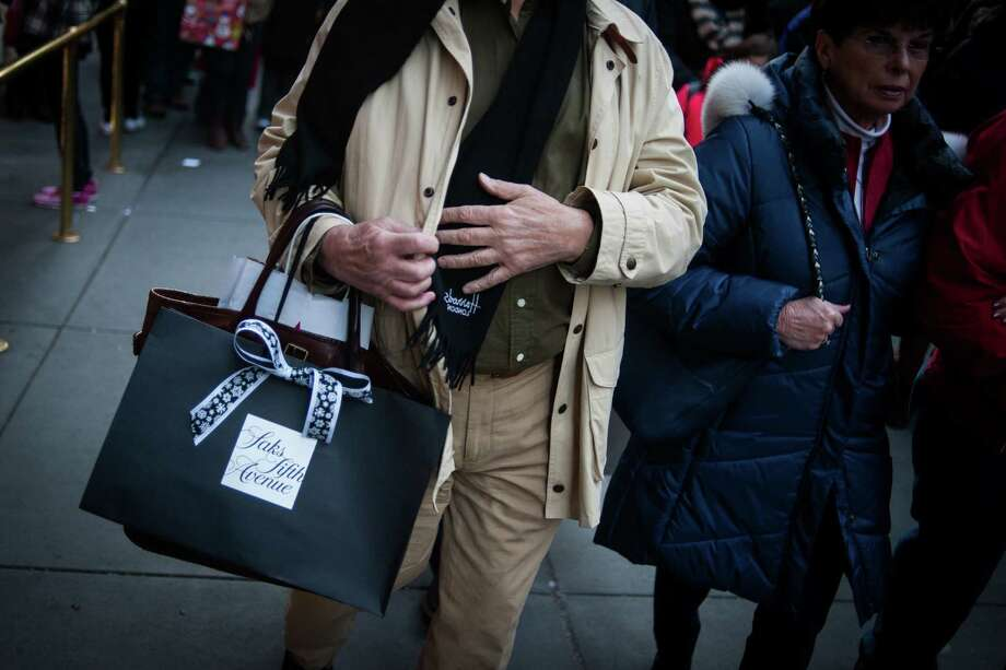 A New York shopper has a Saks Fifth Avenue bag. Third-quarter consumer spending grew 2.8 percent. Photo: Mark Kauzlarich / © 2016 Bloomberg Finance LP
