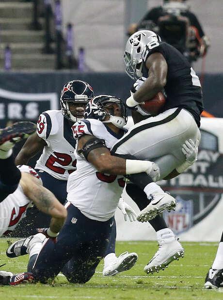 Texans linebacker Benardrick McKinney wraps up the Raiders' Latavius Murray for one of his 101 tackles this season. Photo: Brett Coomer, Staff / © 2016 Houston Chronicle