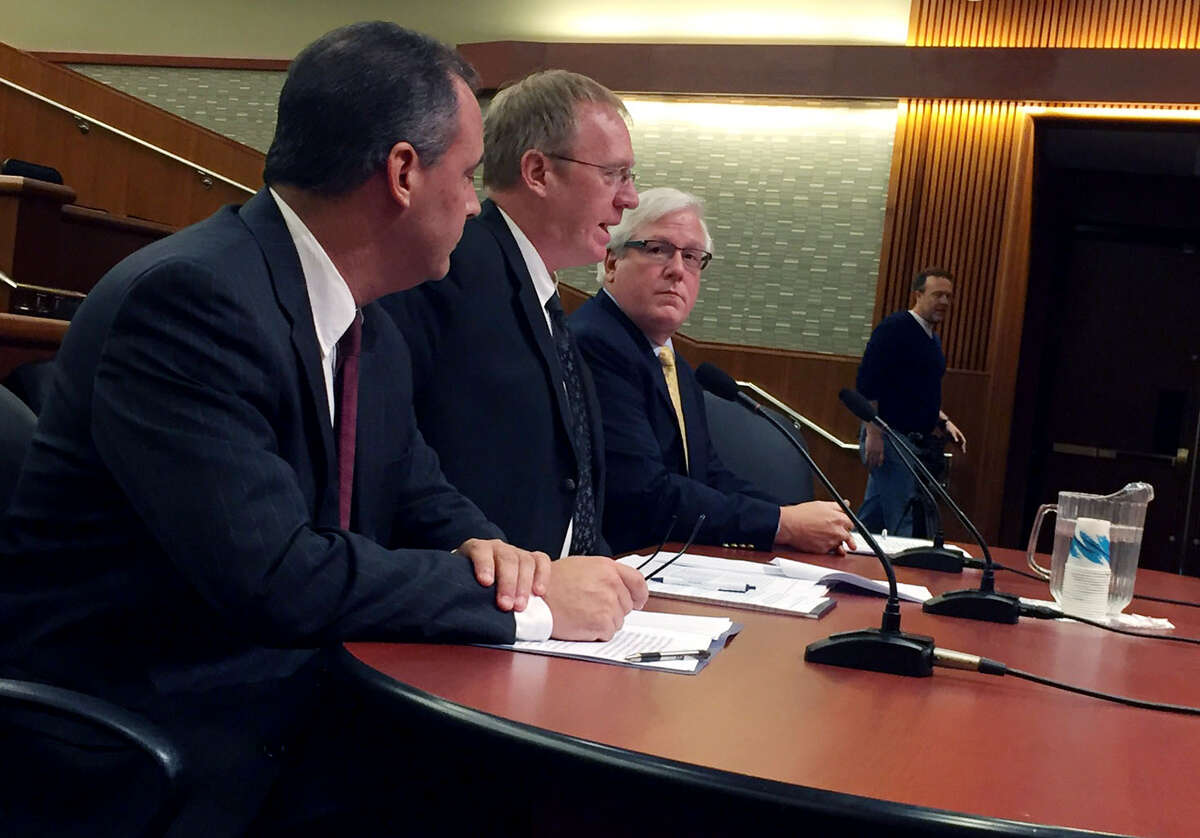 State Board of Elections officials William Cross, left, Todd Valentine and Robert Brehm speak to an Assembly hearing into the security of the electoral system in the Legislative Office Building on Tuesday, Nov. 29, 2016, in Albany, N.Y. (Casey Seiler/Times Union)