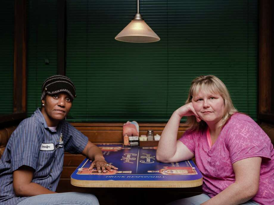 Jennifer Shanklin-Hawkins, left, and Nicole Hargrove are line workers at the Carrier factory in Indianapolis that had been scheduled to lose jobs to Mexico. Carrier says the jobs will stay in Indiana instead. Photo: WHITTEN SABBATINI, STR / NYTNS
