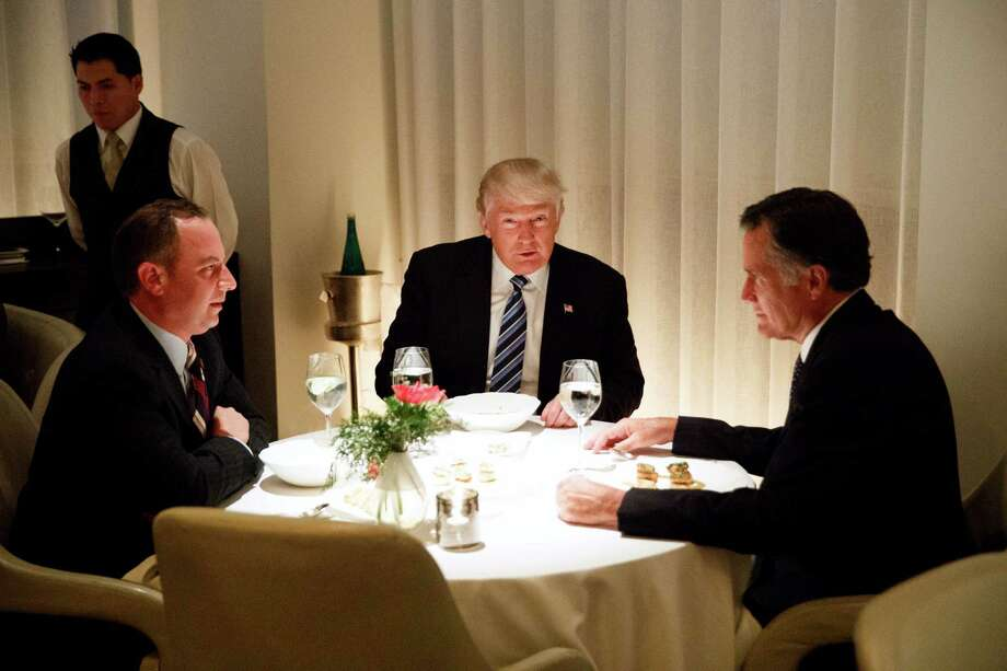 President-elect Donald Trump, center, eats dinner with Mitt Romney, right, and Trump Chief of Staff Reince Priebus at Jean-Georges restaurant on Tuesday in New York. Photo: Evan Vucci, STF / Copyright 2016 The Associated Press. All rights reserved.