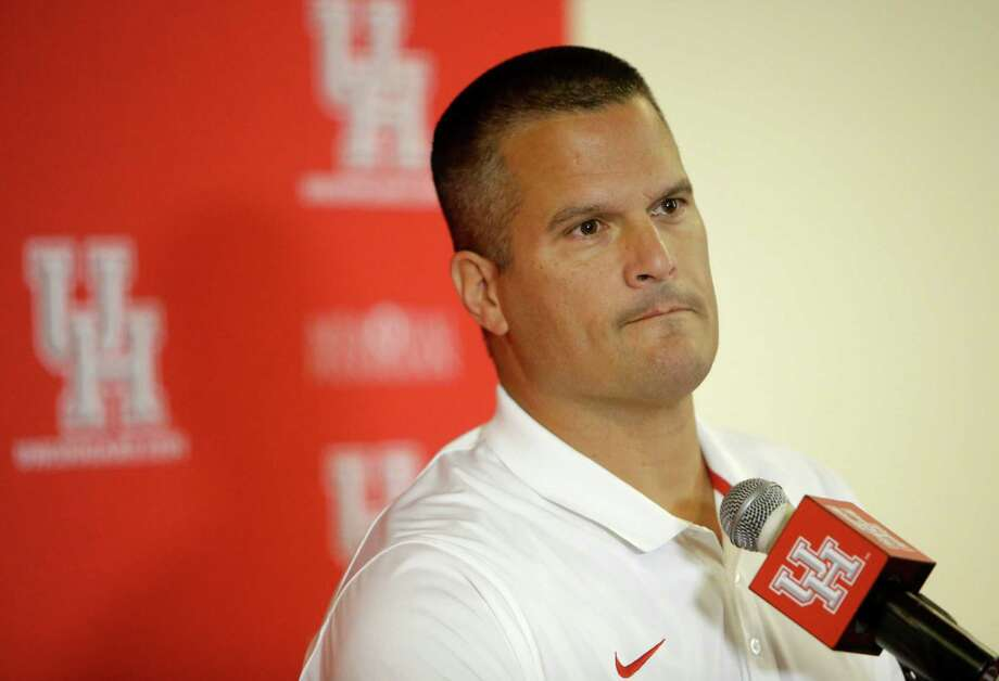 While taking over the headlining duties at Tuesday's weekly news conference, UH interim coach Todd Orlando made a case for why  interim should be removed from his title when the school selects Tom Herman's successor. Photo: Melissa Phillip, Staff / © 2016 Houston Chronicle
