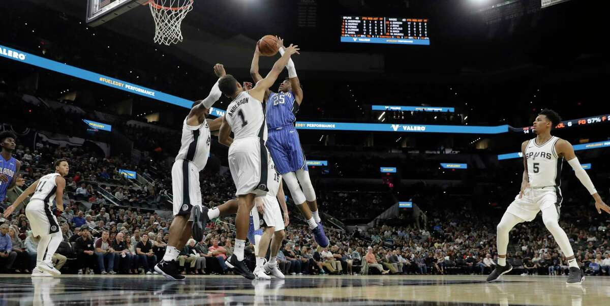Orlando Magic guard Wesley Iwundu (25) drives to the basket against San Antonio Spurs guard Kyle Anderson (1) during the first half of a preseason NBA basketball game, Tuesday, Oct. 10, 2017, in San Antonio. (AP Photo/Eric Gay)