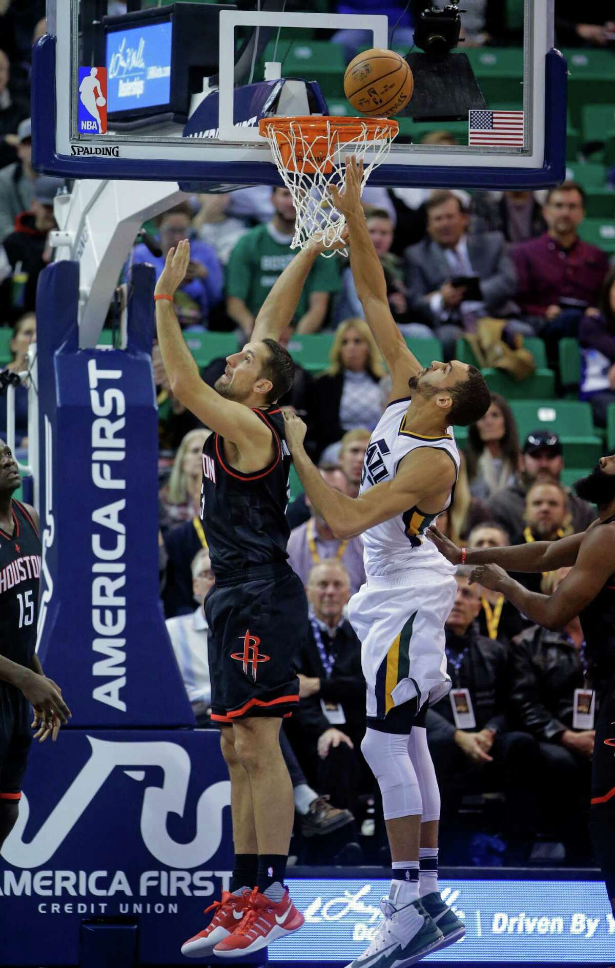 Houston Rockets forward Ryan Anderson, left, and Utah Jazz center Rudy Gobert battle for a rebound in the first half of an NBA basketball game Tuesday, Nov. 29, 2016, in Salt Lake City. (AP Photo/Rick Bowmer)
