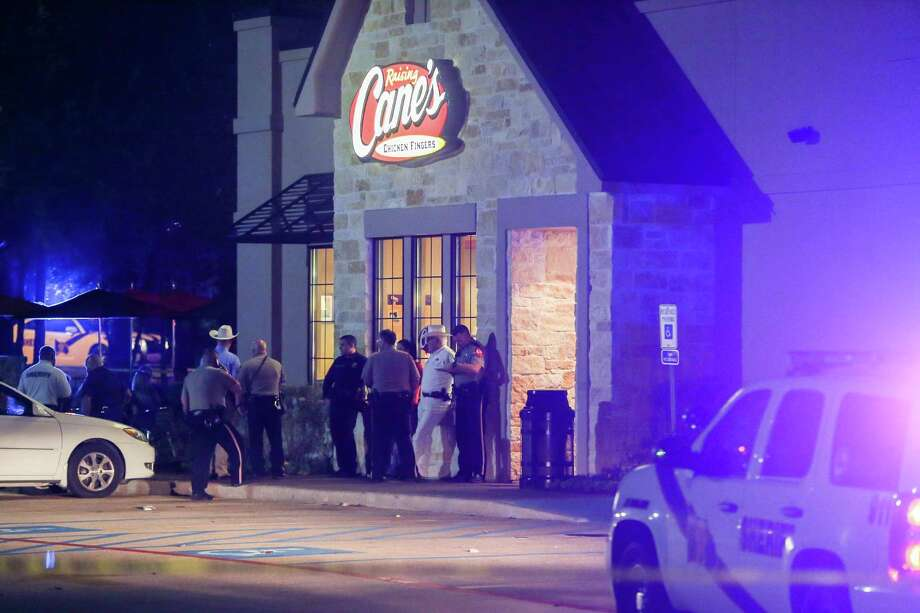 Montgomery County Sheriff's Office investigates an officer-involved shooting at a Raising Cane's in Shenandoah on Nov. 22. Photo: Michael Minasi, Staff / © 2016 Houston Chronicle