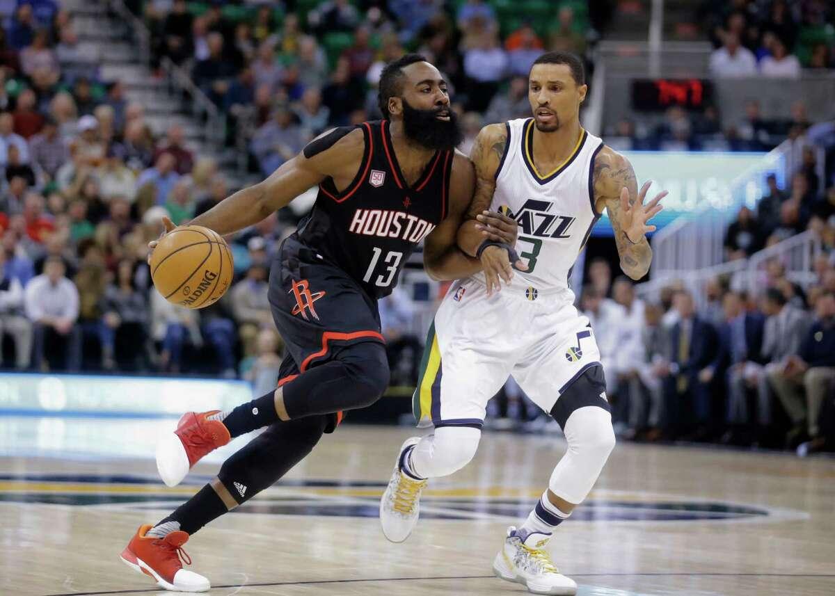 Houston Rockets guard James Harden (13) drives on Utah Jazz guard George Hill (3) in the first half of an NBA basketball game Tuesday, Nov. 29, 2016, in Salt Lake City. (AP Photo/Rick Bowmer)