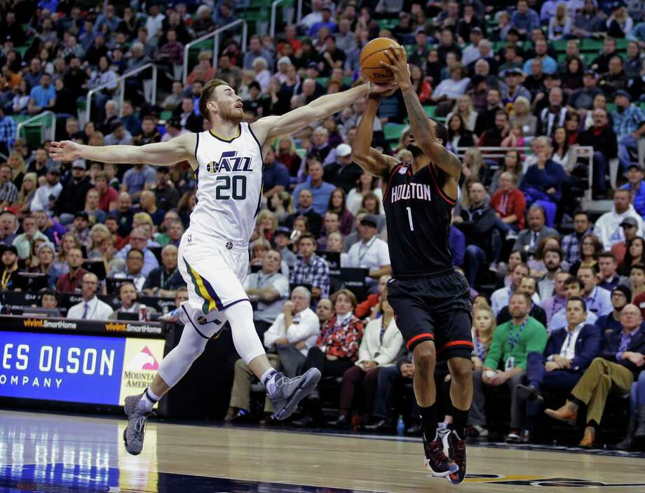 Utah Jazz forward Gordon Hayward (20) breaks up a pass to Houston Rockets forward Trevor Ariza (1) in the first half of an NBA basketball game Tuesday, Nov. 29, 2016, in Salt Lake City. (AP Photo/Rick Bowmer) Photo: Rick Bowmer, STF / Copyright 2016 The Associated Press. All rights reserved.
