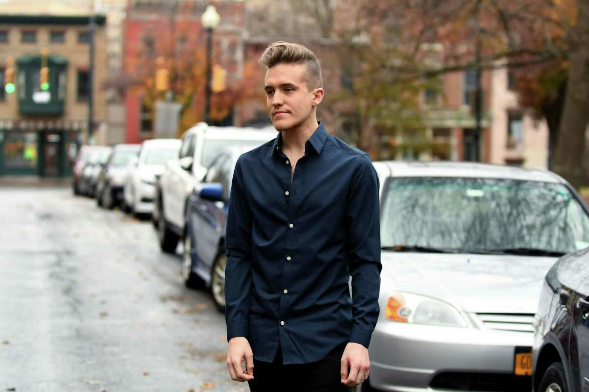 Kyle Arnold, a waiter at El Loco who is gay and lives near Washington Park, is pictured on Tuesday, Nov. 29, 2016, in Albany, N.Y. Arnold says he?'s faced harassment since Donald Trump?'s election and someone recently left a note on his car filled with homophobic rants. It was signed ?