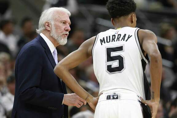 Spurs head coach Gregg Popovich talks with Dejounte Murray (05) during their game against the Orlando Magic at the AT&T Center on Tuesday, Nov. 29, 2016. The Magic defeated the Spurs, 95-83. (Kin Man Hui/San Antonio Express-News)