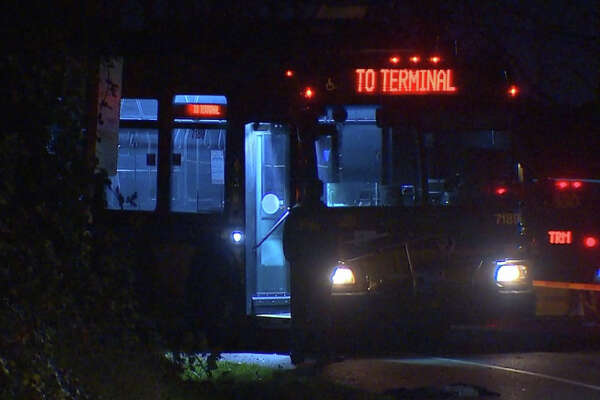 A shooting Tuesday evening aboard a King County Metro bus left one man critically injured and another jailed.