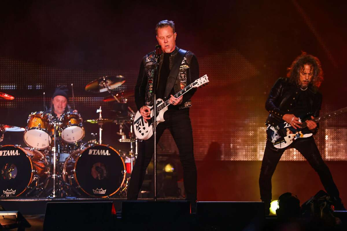 """Drummer Lars Ulrich, guitarist James Hetfield and lead guitarist Kirk Hammett, of Metallica perform on stage together at the CBS RADIO�s """"The Night Before"""" concert at AT&T Park venue in San Francisco, California on Saturday, February 6, 2016."""