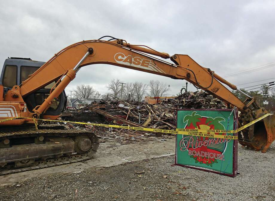 Remains of the burned Riverside Roadhouse in Caseville get cleaned up. A new restaurant and tavern is planned for next summer.