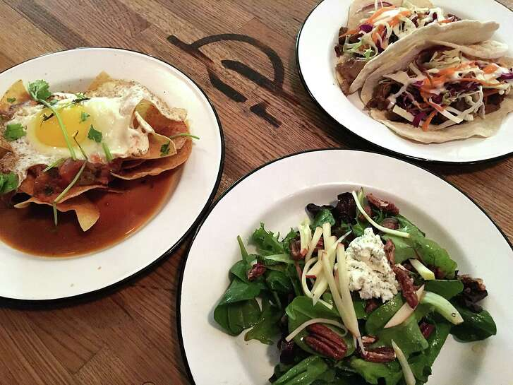 Jazz, TX isn't just a music venue at The Pearl. The kitchen turns out an abbreviated menu that includes chilaquiles, top left, brisket tacos with foie gras and a goat cheese salad with candied pecans apples.