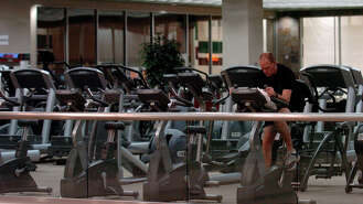 Nearly 1,000 employees in the Houston area of Minnesota-based Life Time Fitness will be receiving checks for $61 to reimburse them for getting shorted on the minimum wage during their first week on the job, according to a settlement the company reached with the U.S. Department of Labor.  Life Time Fitness agreed to pay a total of $977,000 - which includes $488,000 in back wages and an equal amount in damages - to employees after a federal investigation found the company violated federal minimum wage laws at health clubs in 26 states, including Texas.