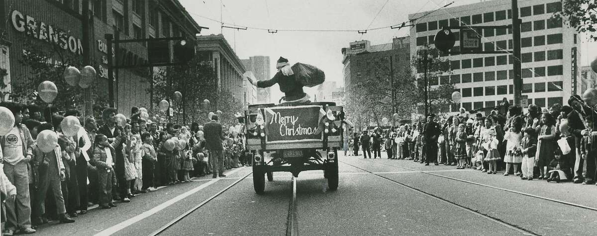 Santa parade down Market Street, downtown San Francisco, sponsored by the old Emporium Capwell store, November 21, 1982.