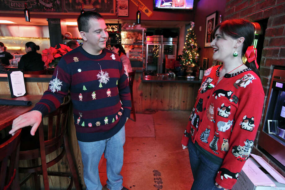 Max's Wine Dive employees Martin Flores (left) and Abby Osborn talk during Max's Wine Dive's Ugly Sweater Day Friday Dec. 14, 2012. Photo: Edward A. Ornelas, Staff / © 2012 San Antonio Express-News
