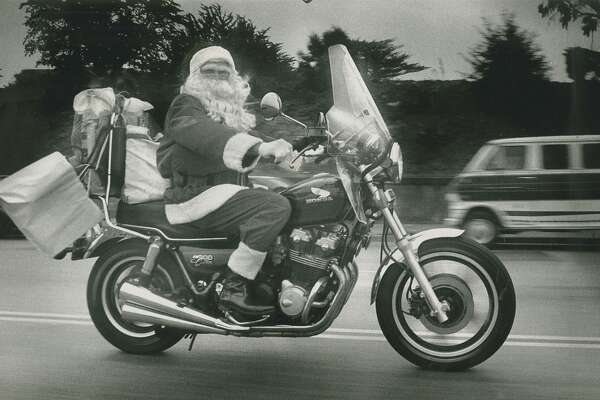"""Ron Arvin (alias """"Santa Claus) is on his  way to work as the Muni Santa. Each year he played Santa on the Muni Christmas Bus that traveled through the city, December 19, 1989."""
