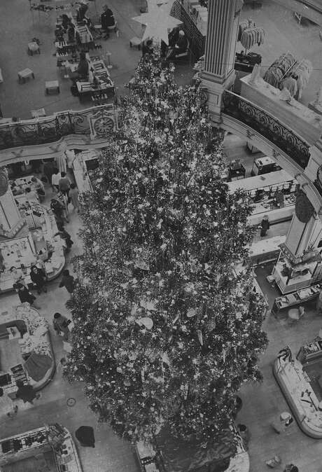 Christmas tree in the City of Paris Department Store in San Francisco, November 22, 1965. The tree stood 40 feet tall, and was decorated by workers on scaffolding erected after the tree was in place. Photo: Art Frisch, San Francisco Chronicle