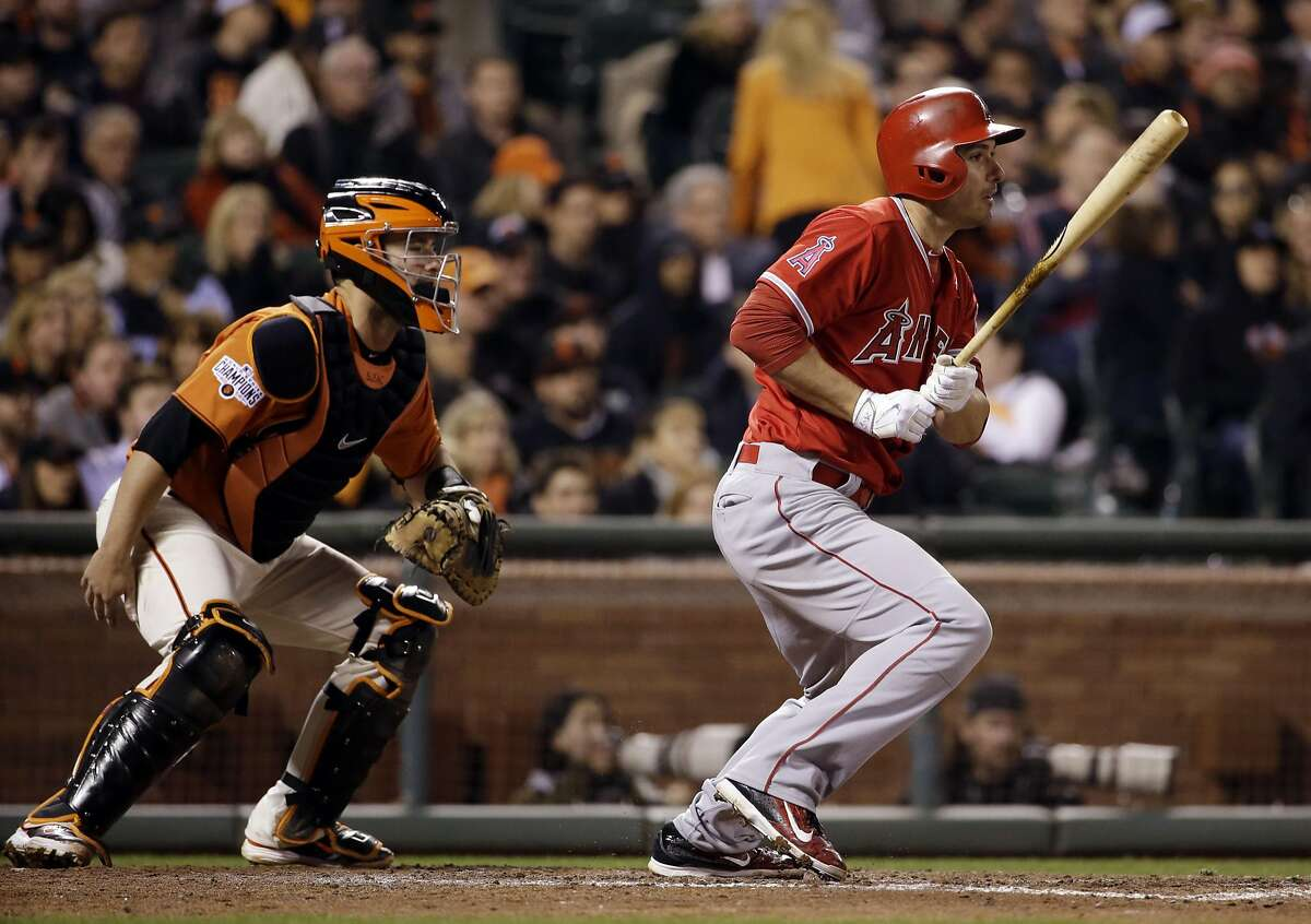 Los Angeles Angels' Matt Joyce drives in a run with a single against the San Francisco Giants during the seventh inning of a baseball game on Friday, May 1, 2015, in San Francisco. (AP Photo/Marcio Jose Sanchez)