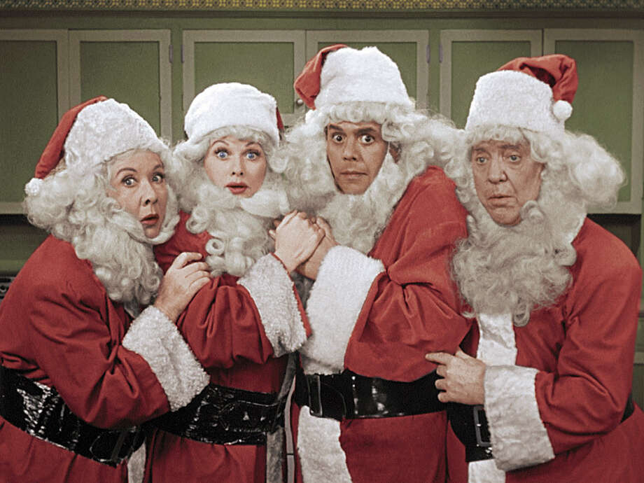 "I Love Lucy Christmas SpecialDec. 2, 8 p.m. Channel: CBSA package deal with two colorized half-hours, the December 1956 ""Christmas Episode"" and 1955's ""Lucy Gets in Pictures,"" with Lucille Ball navigating a staircase under the burden of a feathered headdress.Photo: (CBS via AP) Photo: SCREEN GRAB, AP / é2014 CBS Broadcasting, Inc. All Rights Reserved"