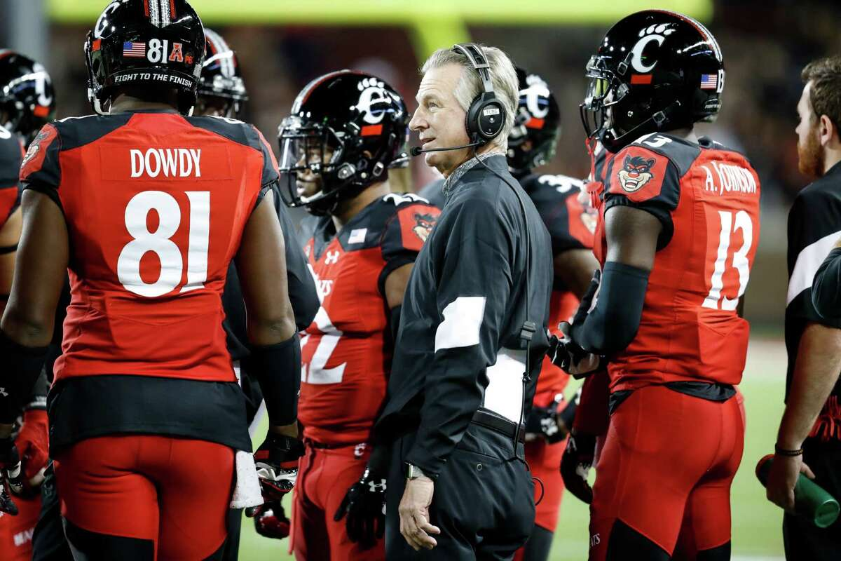 Cincinnati head coach Tommy Tuberville works the sidelines in the first half of an NCAA college football game against Memphis, Friday, Nov. 18, 2016, in Cincinnati. (AP Photo/John Minchillo)