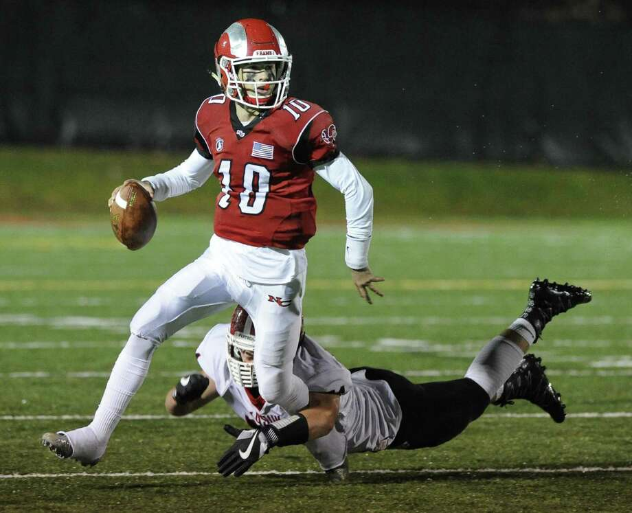 New Canaan Drew Pyne is brought down from behind by Masuk Max Mirizio in a CIAC Class L football game in New Canaan on Nov. 29, 2016. Photo: Matthew Brown / Hearst Connecticut Media / Stamford Advocate